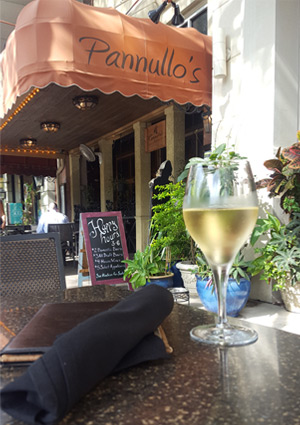 Wine Glass and Menu with Pannullos awning in background